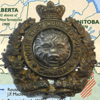 Photograph of NWMP cap badge on map