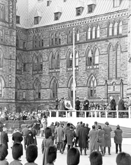 1965 - Photograph of the new Canadian flag being raised at the Canadian Parliament (Source of photo - Ric Hall's Photo Collection).