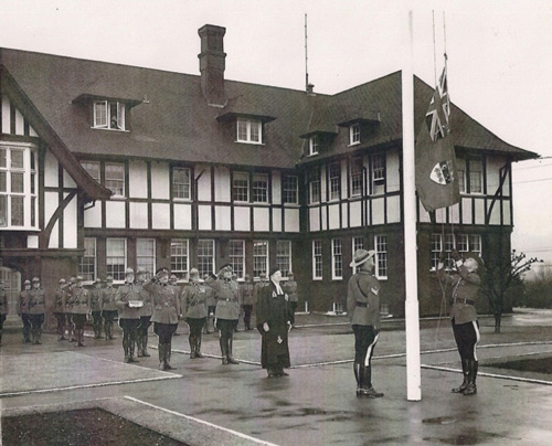 1965 - Photograph at the RCMP Fairmount Barrack in Vancouver - Taking down the Canadian Ensign (Source of photo - Ric Hall's Photo Collection).