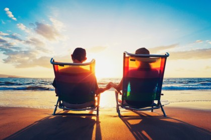 Photo Couples Beach Chairs Sunset