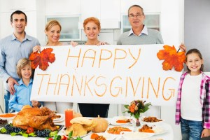 Large cheerful family celebrating Thanksgiving day. They are holding a big white paper saying Happy Thanksgiving. [url=http://www.istockphoto.com/search/lightbox/9786778][img]http://dl.dropbox.com/u/40117171/family.jpg[/img][/url]