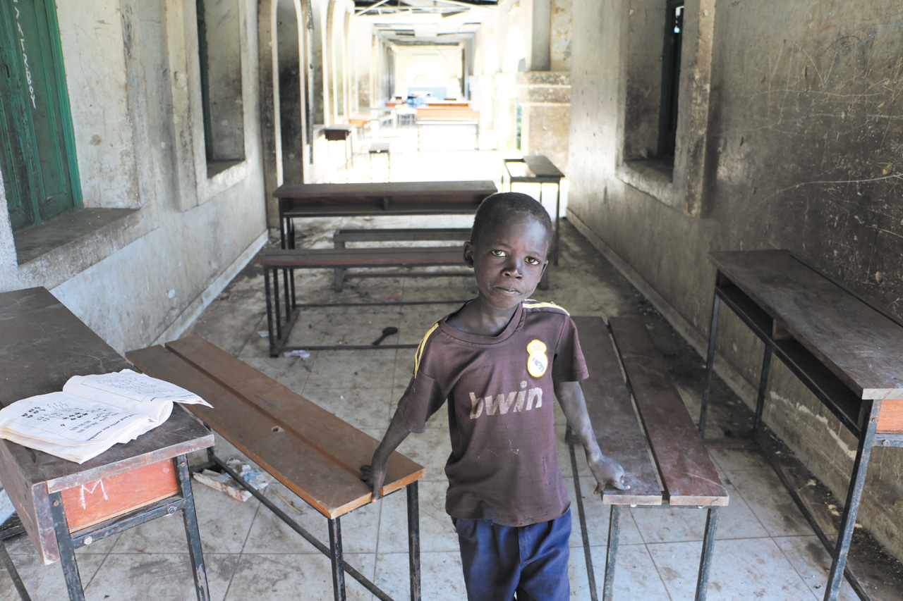 ICRC caption: In the town of Kodok, South Sudan, a boy stands in a shuttered school, where classes have been closed for months after fighting intensified in the area. Photo: Jason Straziuso/ICRC