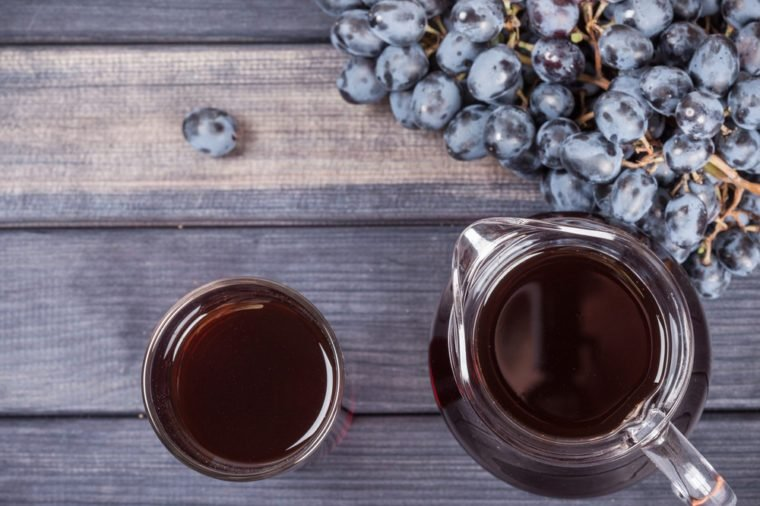 black grapes and juice in the jug top view