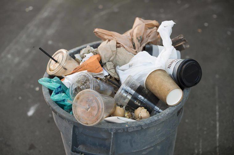 BROOKLYN, NY - May 25, 2015: A bin-full of trash on the street of New York City.