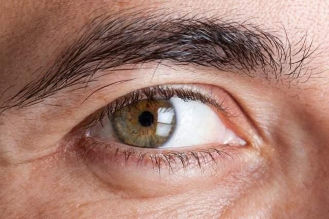 Macro shot of man's green eye