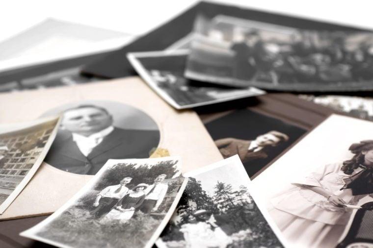 Closeup of a pile of vintage family photos