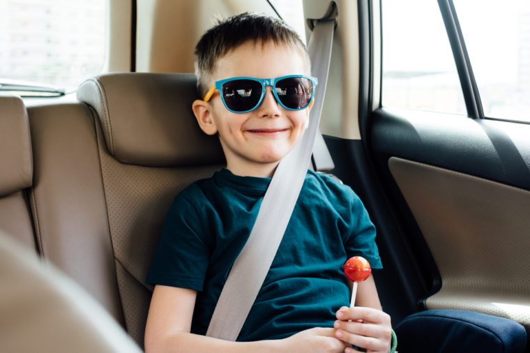 Child in the car with fasten seat belt