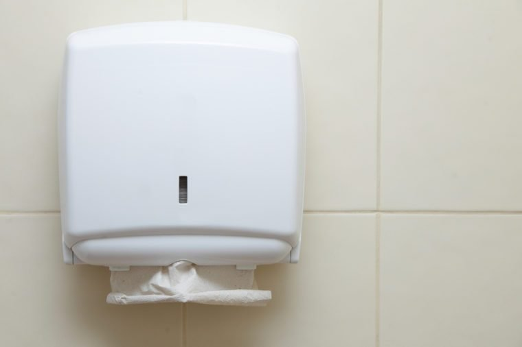 Paper towel dispenser on the wall in the bathroom