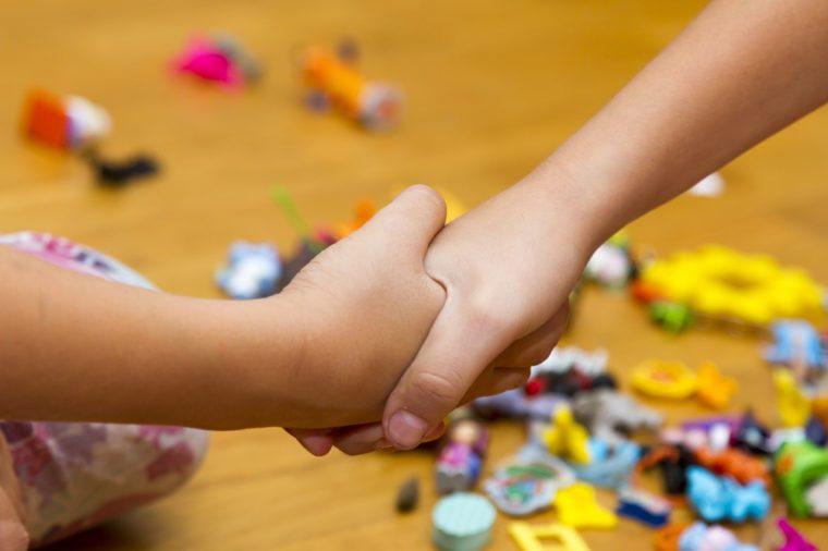child shakes hands