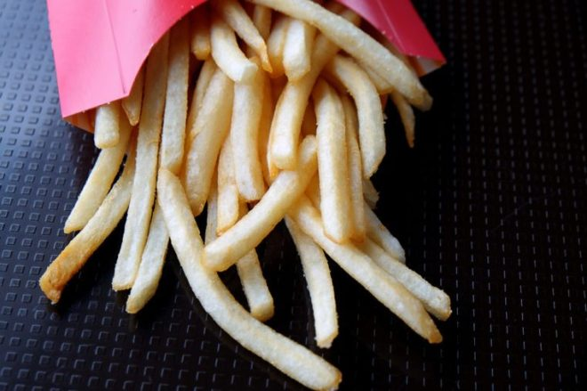 Bangkok, Thailand - 17,July 2018 : A closed up photo of junk food with selective focus on Fresh fried french fries from McDonalds .Editorial only, McDonald's is a brand from America.