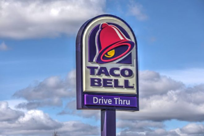 HDR image, Taco Bell restaurant, drive thru highway sign - Revere, Massachusetts USA - March 10, 2018