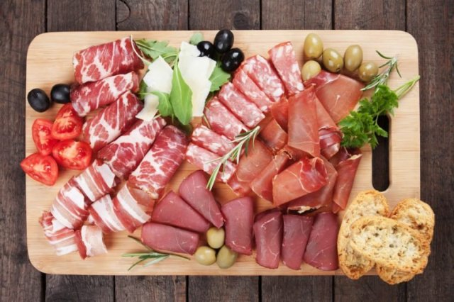 Charcuterie board with prosciutto, capicola and other italian deli cured meat