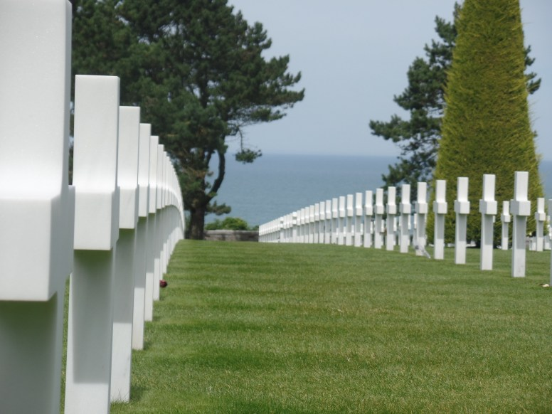 National Cemetery, view down a row of graves, with the English Channel in the background.