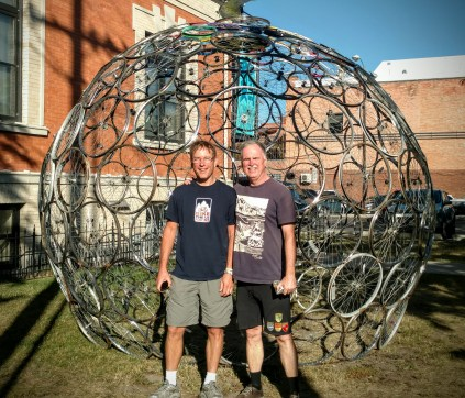 Don and Len next to a cool bicycle-wheel sculpture at the Adventure Cycling Association in Missoula, Montana.