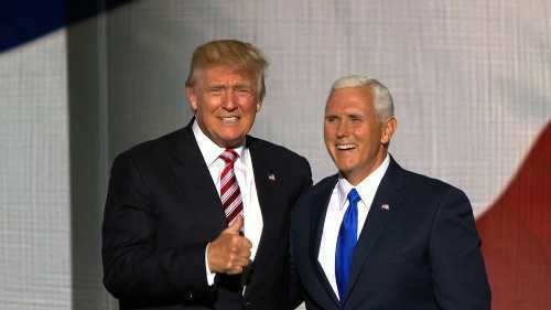 President Trump and Vice President Pence on stage together they are both smiling and look very happy