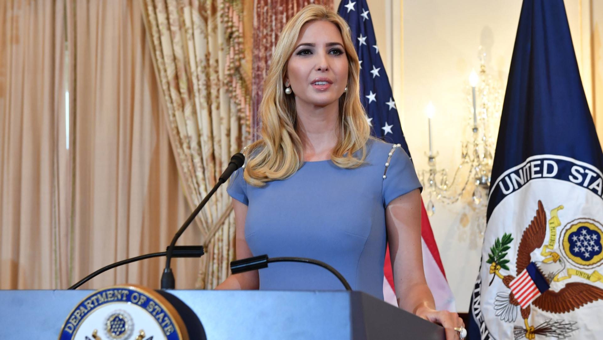 Advisor to the President Ivanka Trump Delivers Remarks at the 2017 Trafficking in Persons Report Launch Ceremony. Ivanka is standing at a podium she is wearing a grey skirt suit.