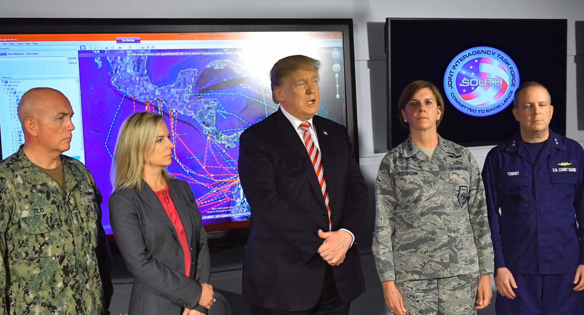 An image of President Donald Trump and Homeland Security Secretary Kirstjen Nielsen tour the Joint Interagency Task Force South, a federal anti-smuggling and anti-drug trafficking agency, at the Naval Air Station Key West in Key West, Florida on April 19, 2018