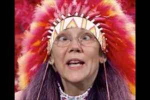 an image of elizabeth warren wearing a american indian head dress of feathers and beads