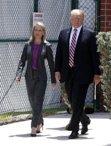 President Trump Walks With Homeland Security Secretary Kirstjen Nielsen on a very sunny day