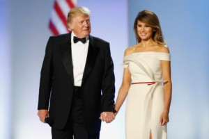 A large image of An image of President Trump with First Lady Melania all dressed up for a state dinner, the president is wearing a black tuxedo and the first lady has on a white dress they both look very happy