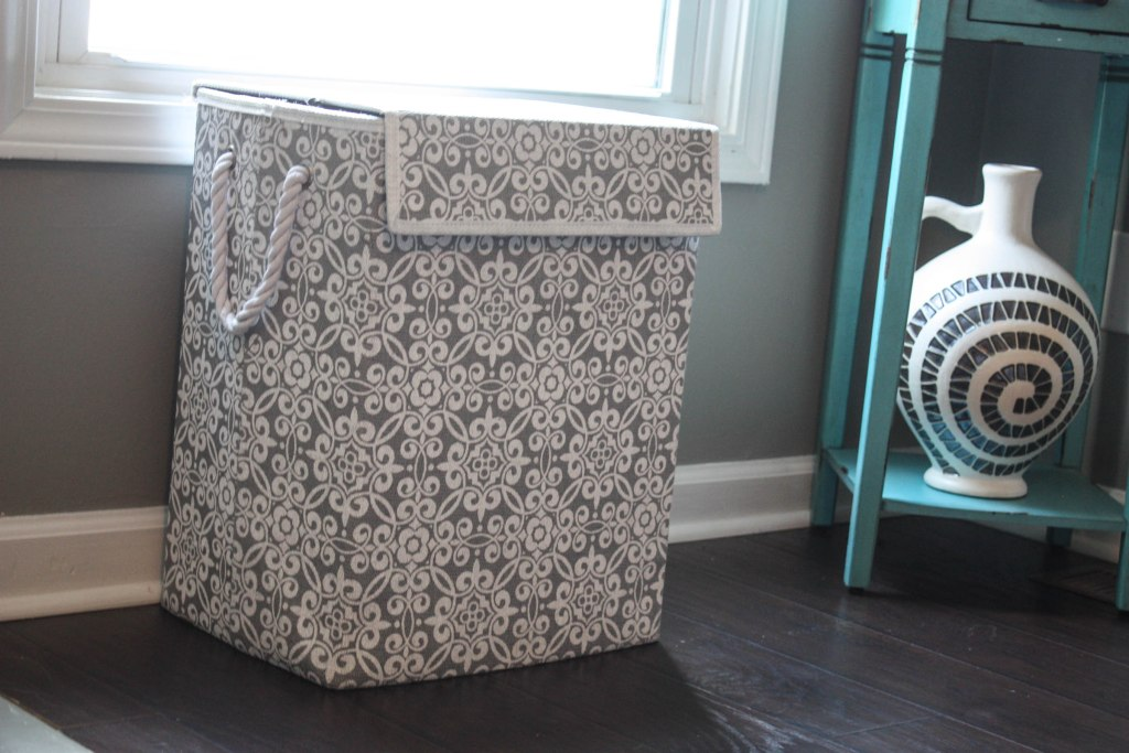 Laundry basket being used for toy storage.