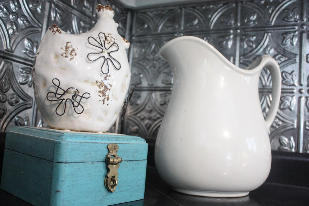 Ceramic hen, milk pitcher and old aqua box