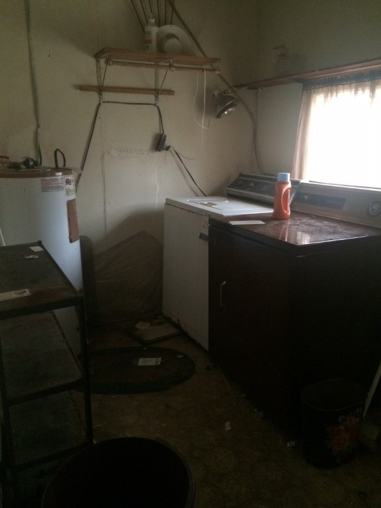fixer upper house before picture-laundry room