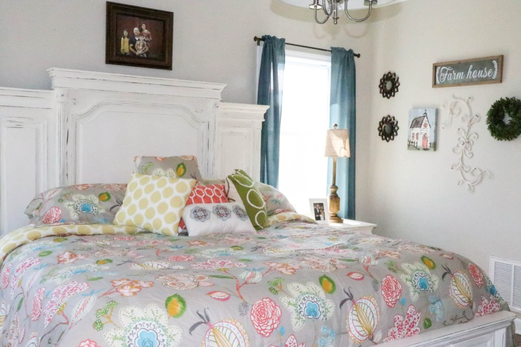 Amazing transformation of a dark and dreary master bedroom into an aqua & coral master bedroom retreat!