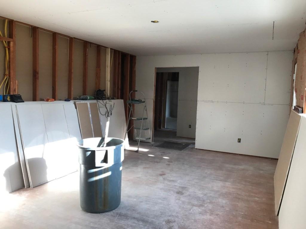 Living room progress at the Cottage Charmer! Sheet rock up!