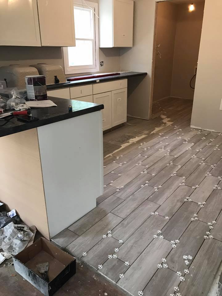 Cottage Charmer Fixer Upper- kitchen update! This flooring is amazing! This house is truly going to be an unbelievable renovation!