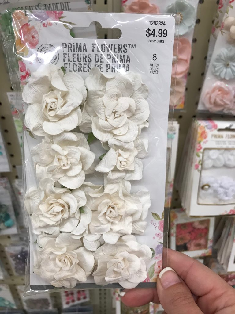 Flower embellishments used to make over a Dollar General chalkboard