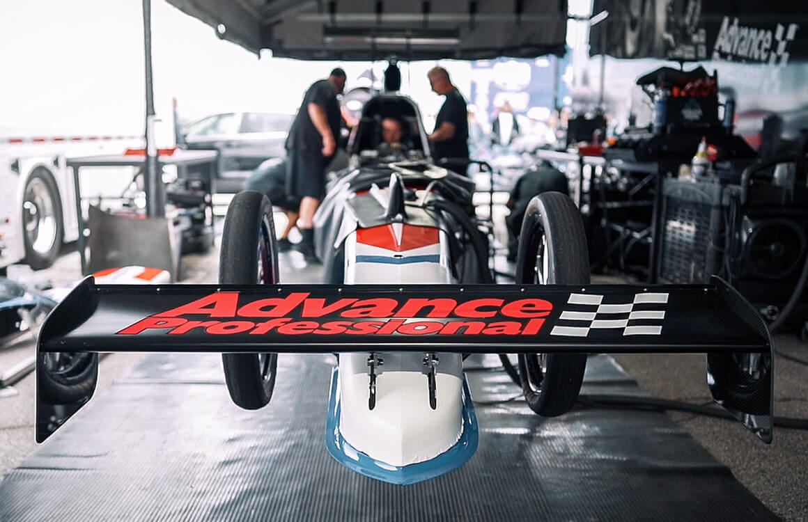 Josh Hart and his Advance Professional team warm up their A/fuel dragster at the 2019 NHRA U.S. Nationals.