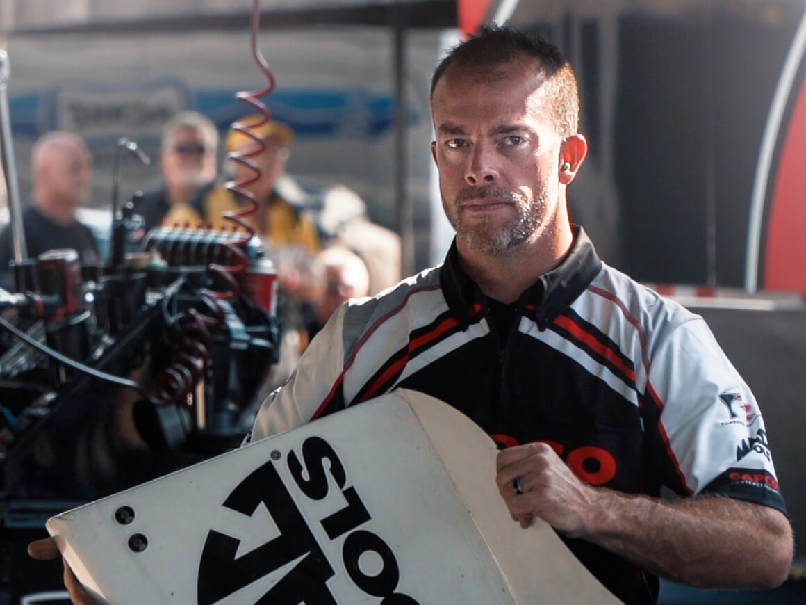 Steve Torrence crew member, Justin Croslin, prepares to reattach a body panel to the Capco Contractors NHRA Top Fuel Dragster at the 2019 NHRA U.S. Nationals.