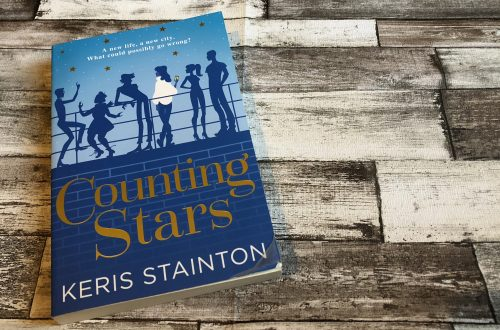 Counting Stars by Keris Stainton book on wooden background