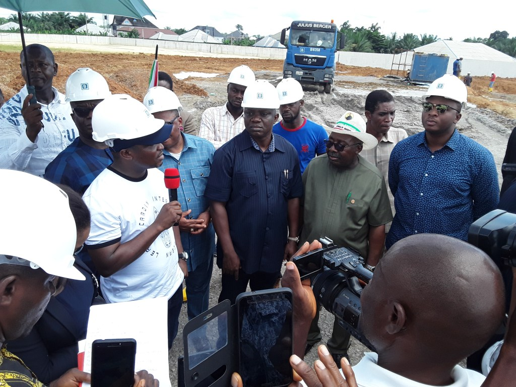 Members of the committee with State Commissioner for Lands and Water Resources, Arch. Ime Ekpo at International Worship Center's cite