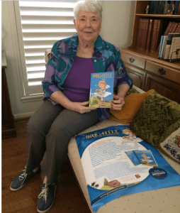 Author Gay Sauer holding her book