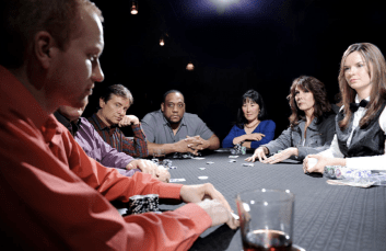 poker game with everyone staring at one player