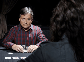 Heads-up poker - guy staring at woman