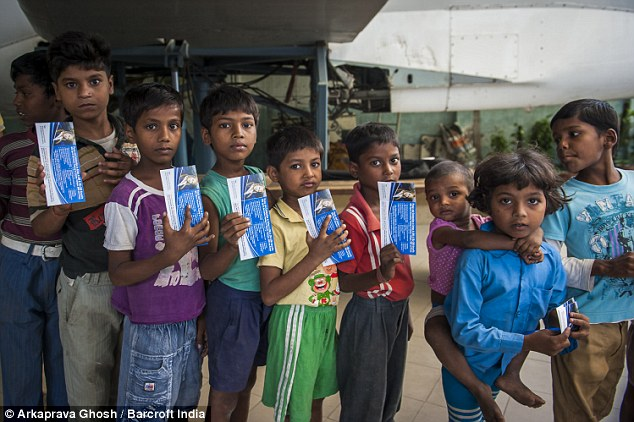 Children in a queue with their boarding passes to experience their first flight