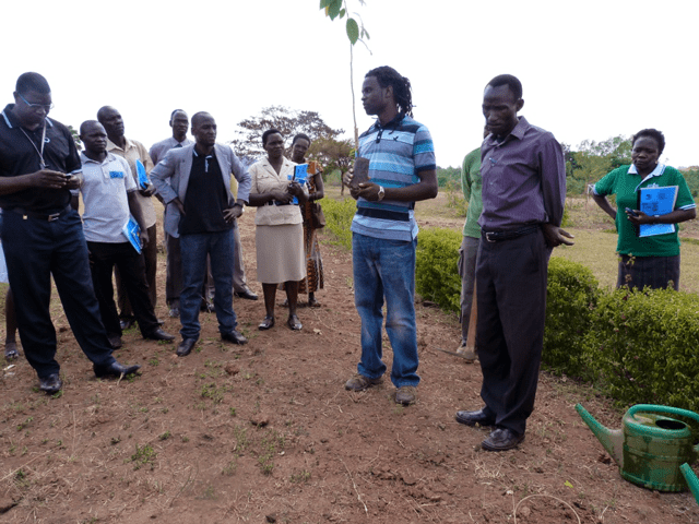 Lance Muteyo planting a tree for peace in Uganda