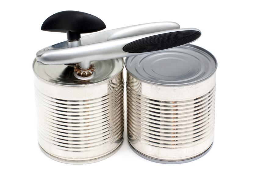 Close up of canned food items and manual can opener