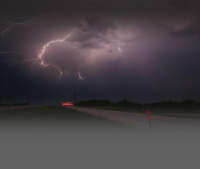 Photo Of A Thunderstorm With Lightning In An Open Landscape At Night