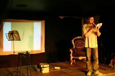 Simon performing a comedy set at Bright Club