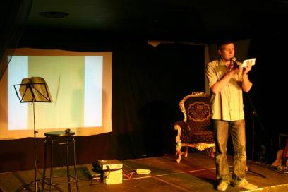 Simon performing a comedy set at Bright Club