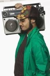 Young man with ghetto blaster - music is among the best memory improvement tips