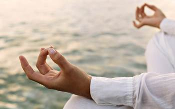 Man sitting meditating - no more information overload!