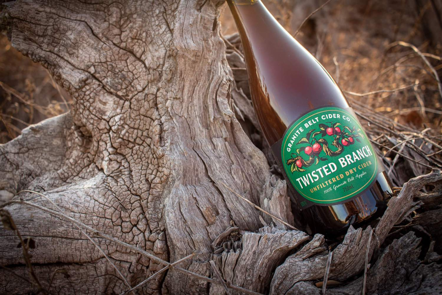 Granite Belt Cider Co Twisted Branch Bottle on a log