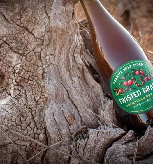 Granite Belt Cider Co Twisted Branch Bottle on a log