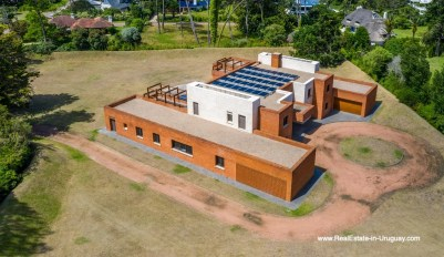 Aerial View of High-Tech State of the Art and Modern Estate on the Brava Beach in Punta del Este with a large Garden