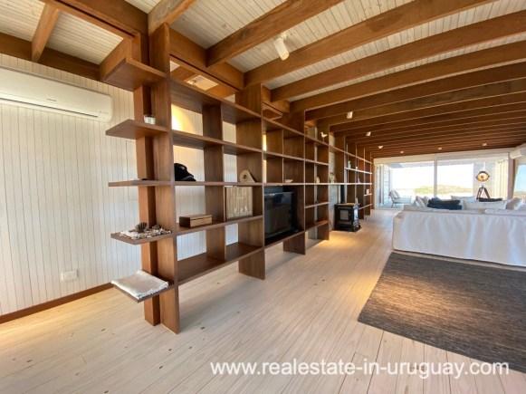 Bookshelf of Frontline Beach Home in San Antonio close to La Pedrera in Rocha with Sea Views